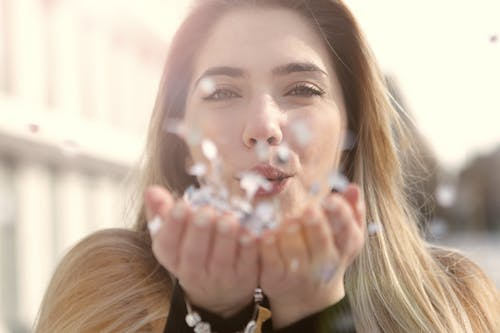 Selective Focus Photo of Woman Blowing