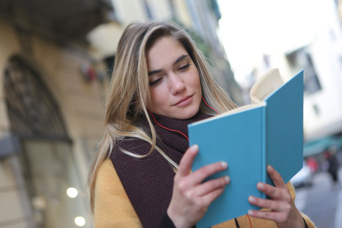 Woman in Purple Scarf Reading A Book