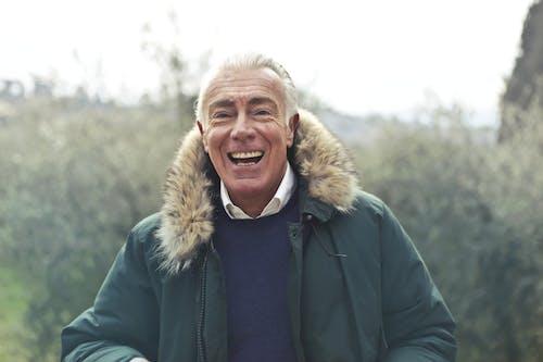 Adult Man Wearing Green Jacket
