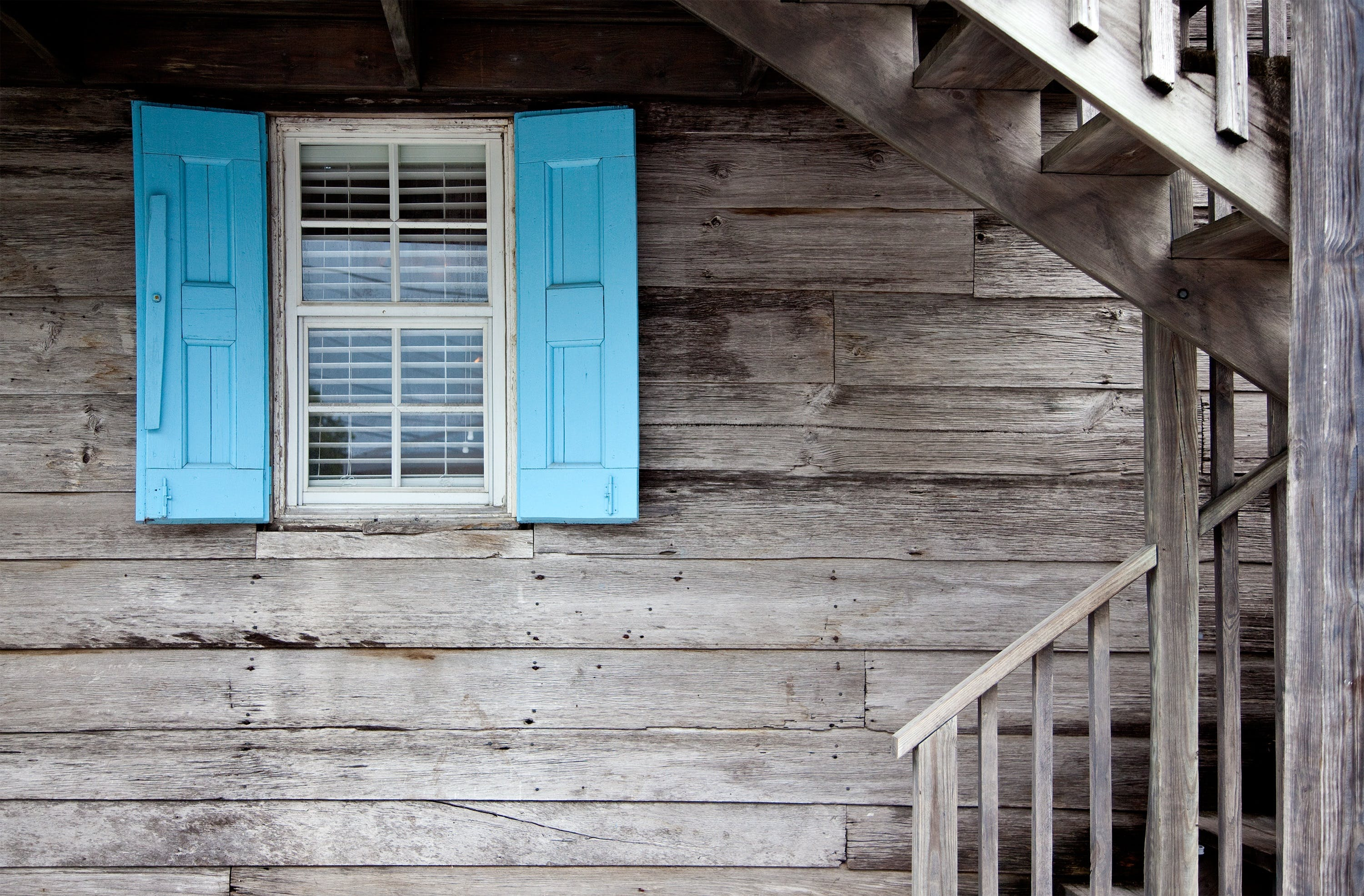Brown Wooden Stair and Blue Window