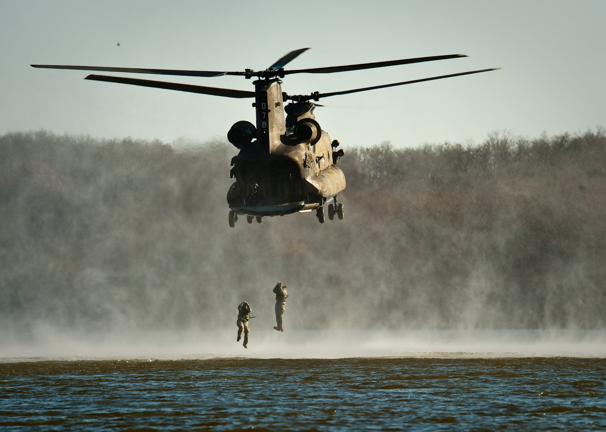 Gray Helicopter Above Body of Water