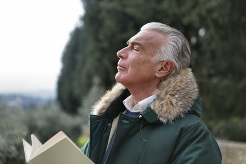 Man in Green and Brown Jacket
