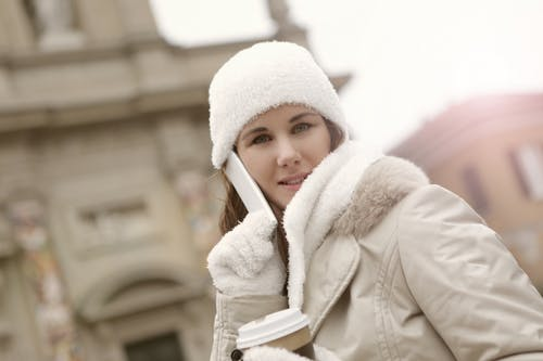 Woman in White Knit Cap and White Coat