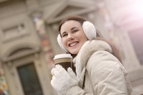 A Joyous Girl Holding a Cup of Coffee