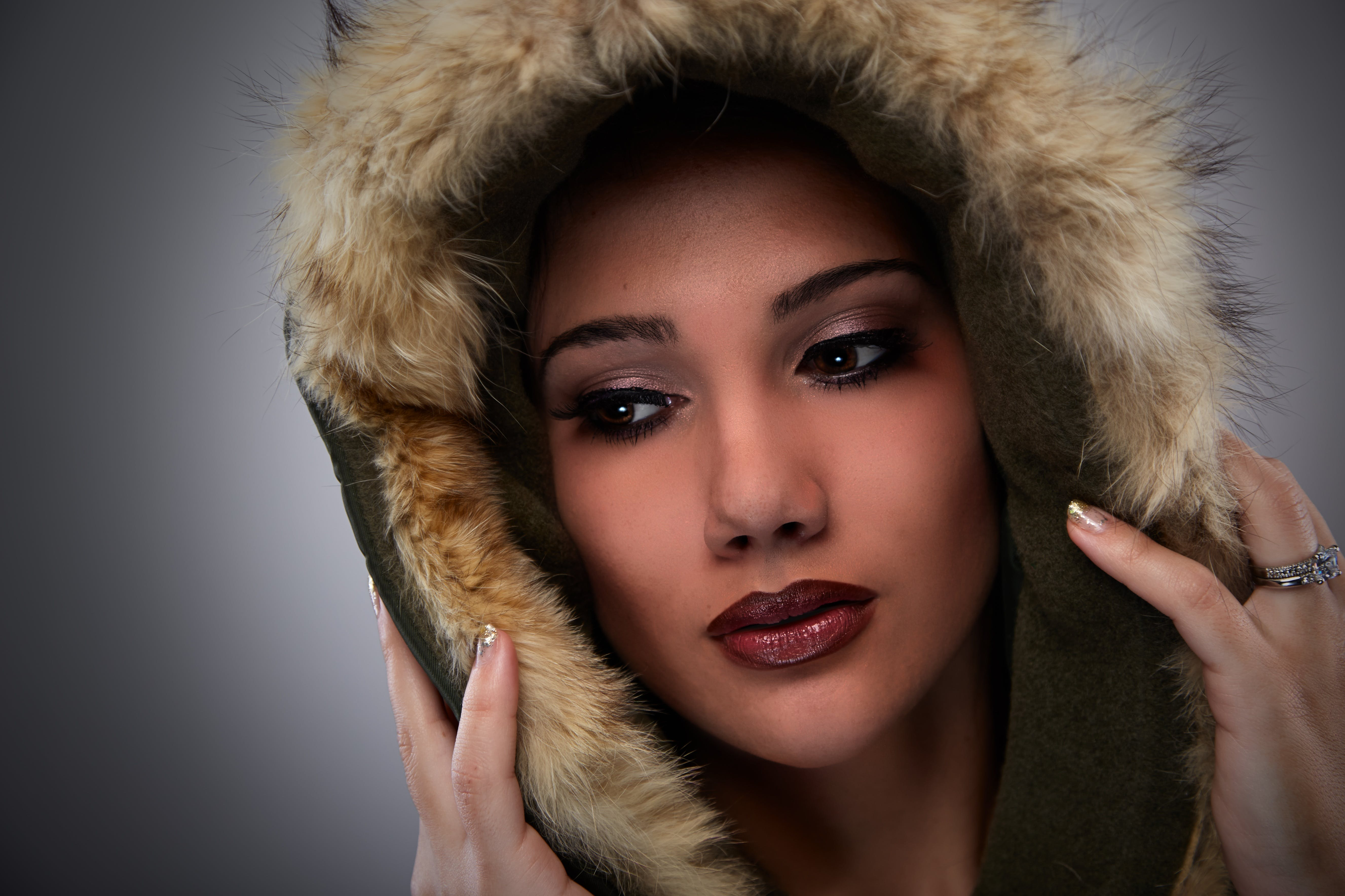 Woman on Black Mascara Red Lipstick Cover Her Face With Brown Fur Coat