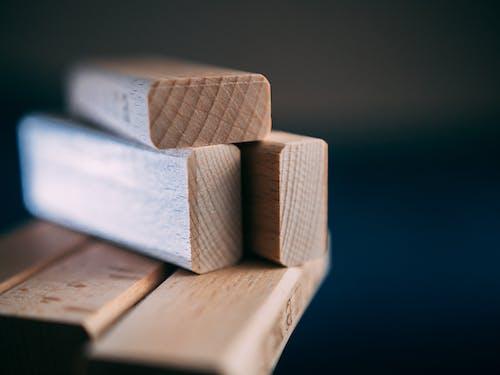 Brown Wooden Blocks on Dark Blue Surface