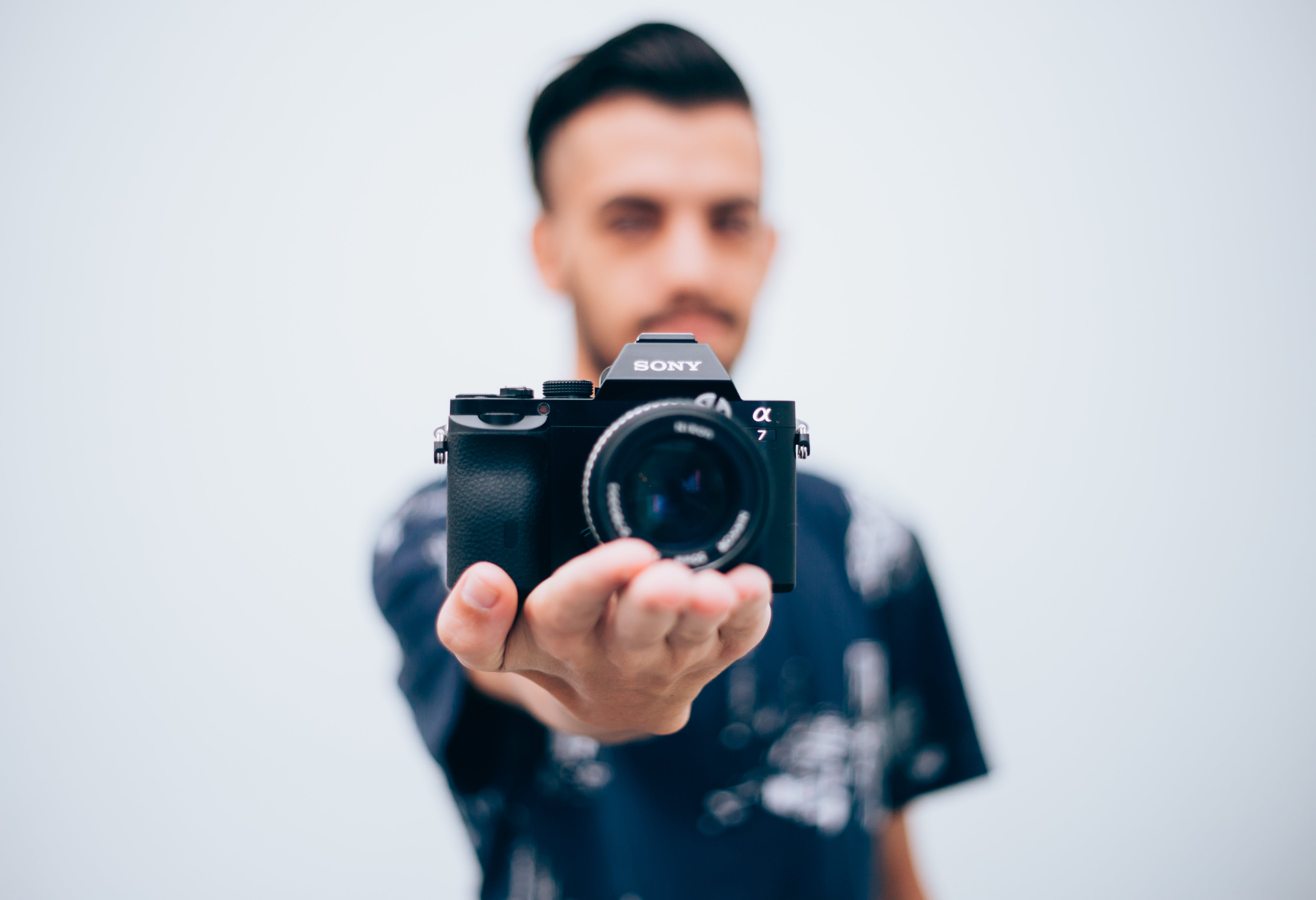 Person Holding Sony Dslr Camera