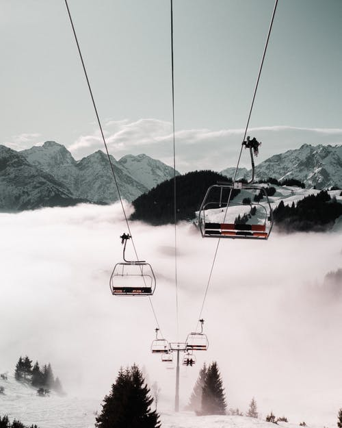 Cable Car  Near Snow Covered Mountain
