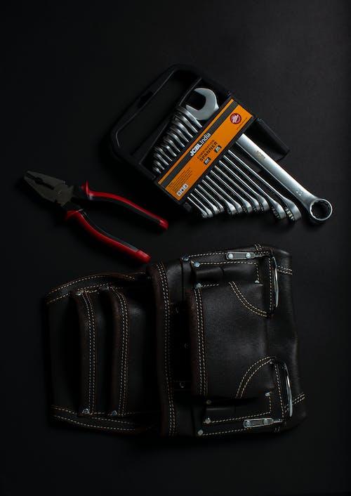 Hand Tool On Black Leather Bag