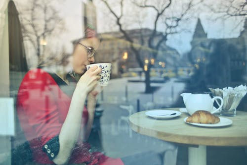 Woman In Red Dress Holding White Ceramic Mug