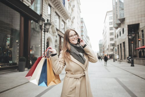 Woman In Brown Coat Standing On Street