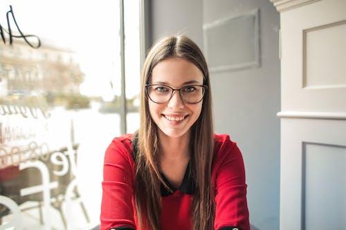 Woman In Red Long Sleeve Wearing Eyeglasses