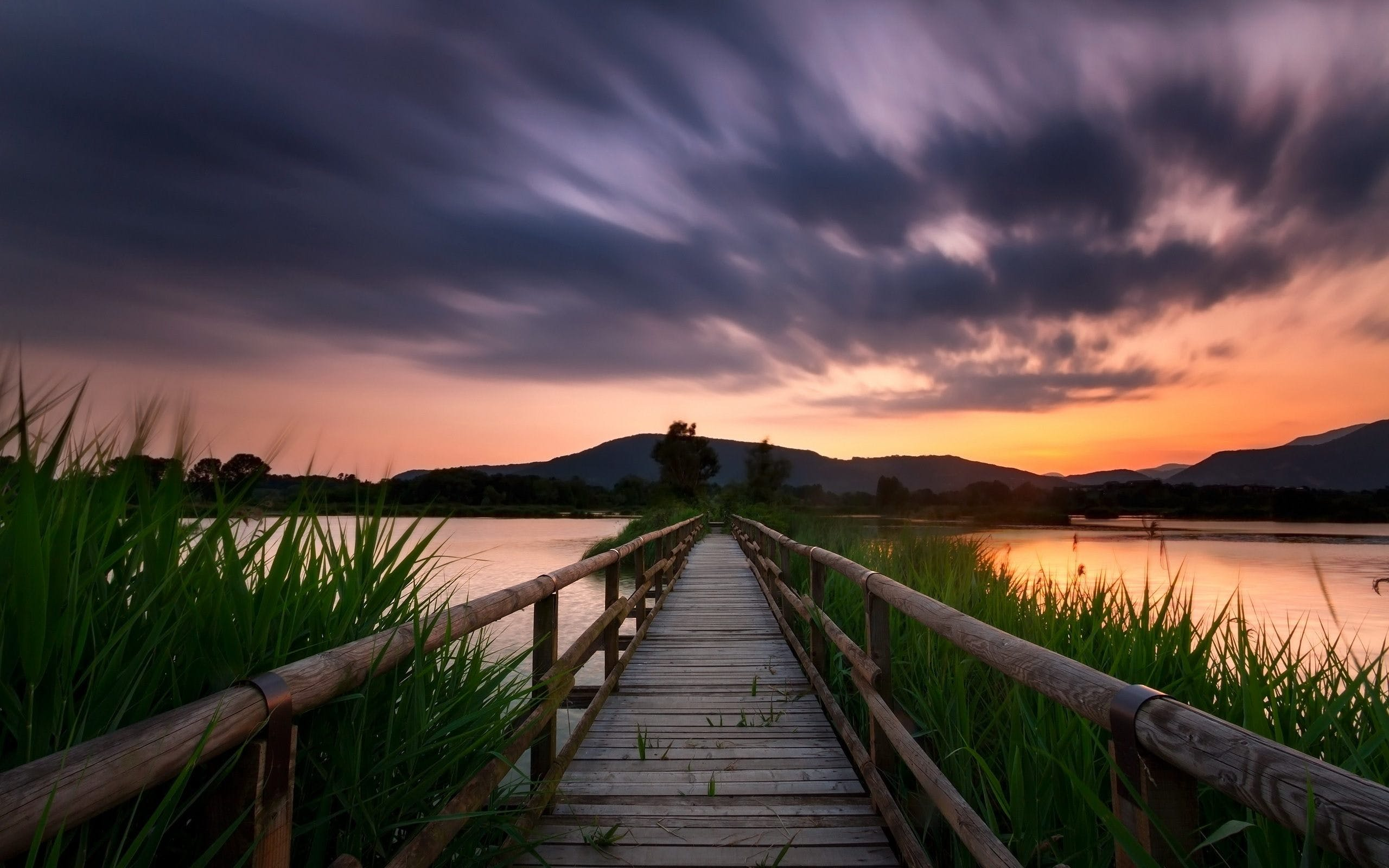 Timelapse Photography of Wooden Bridge Near Body of Water