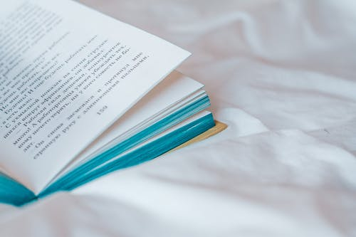 Photo of a Book on White Textile