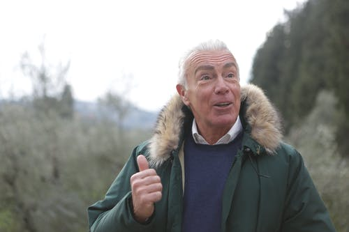 A Grateful Man in Green Parka Jacket
