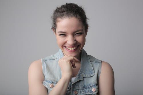 Smiling Girl in Blue Denim Button Up Vest
