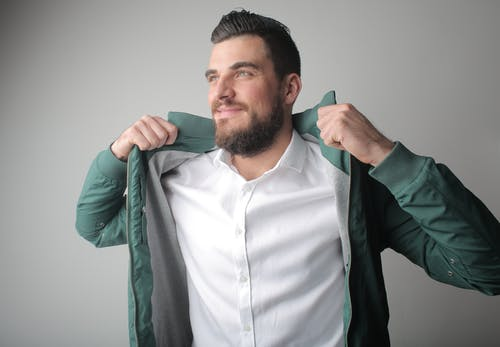 Man in White Shirt and Green Jacket