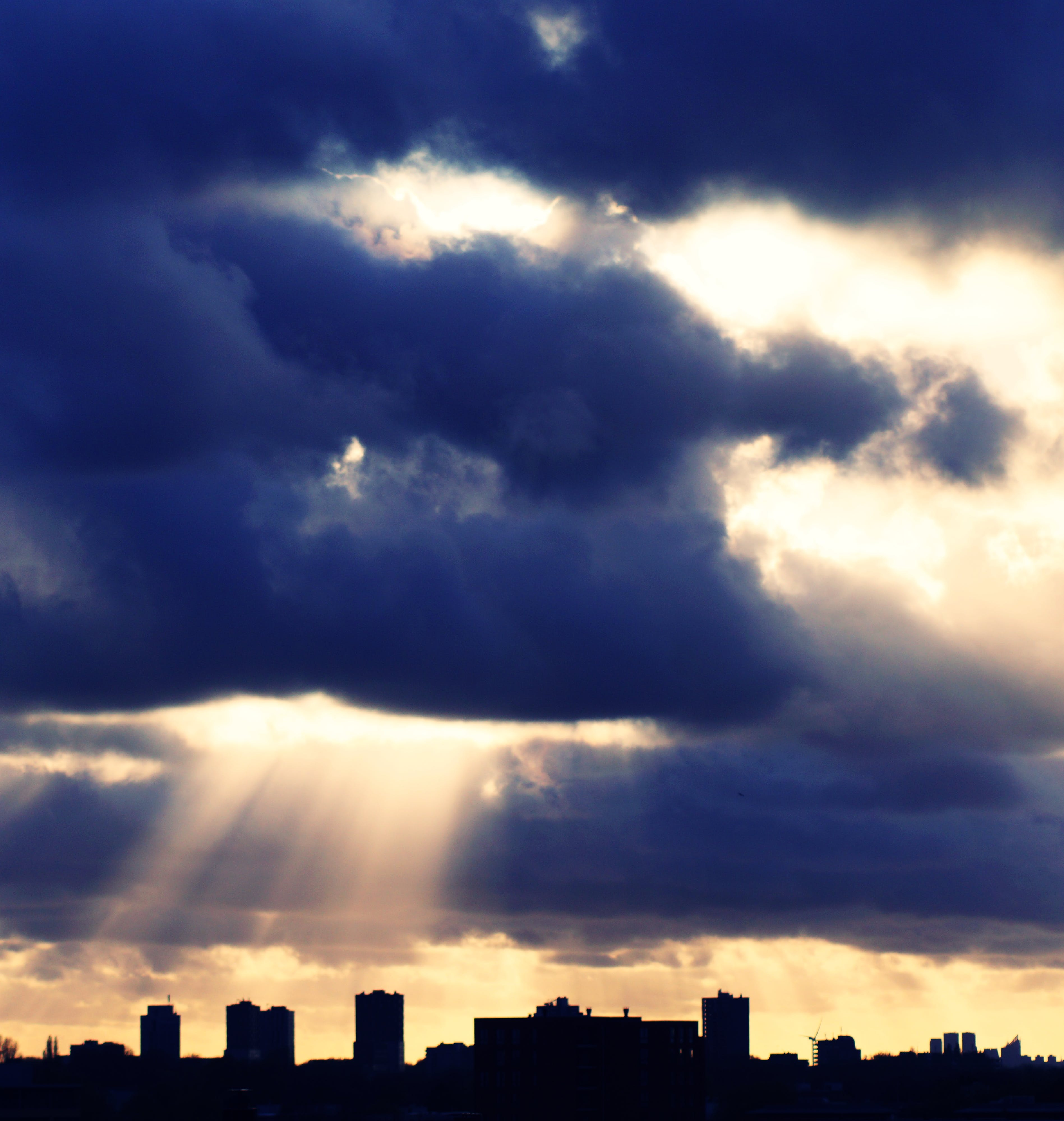 Silhouette of Building Under Cloudy Sky