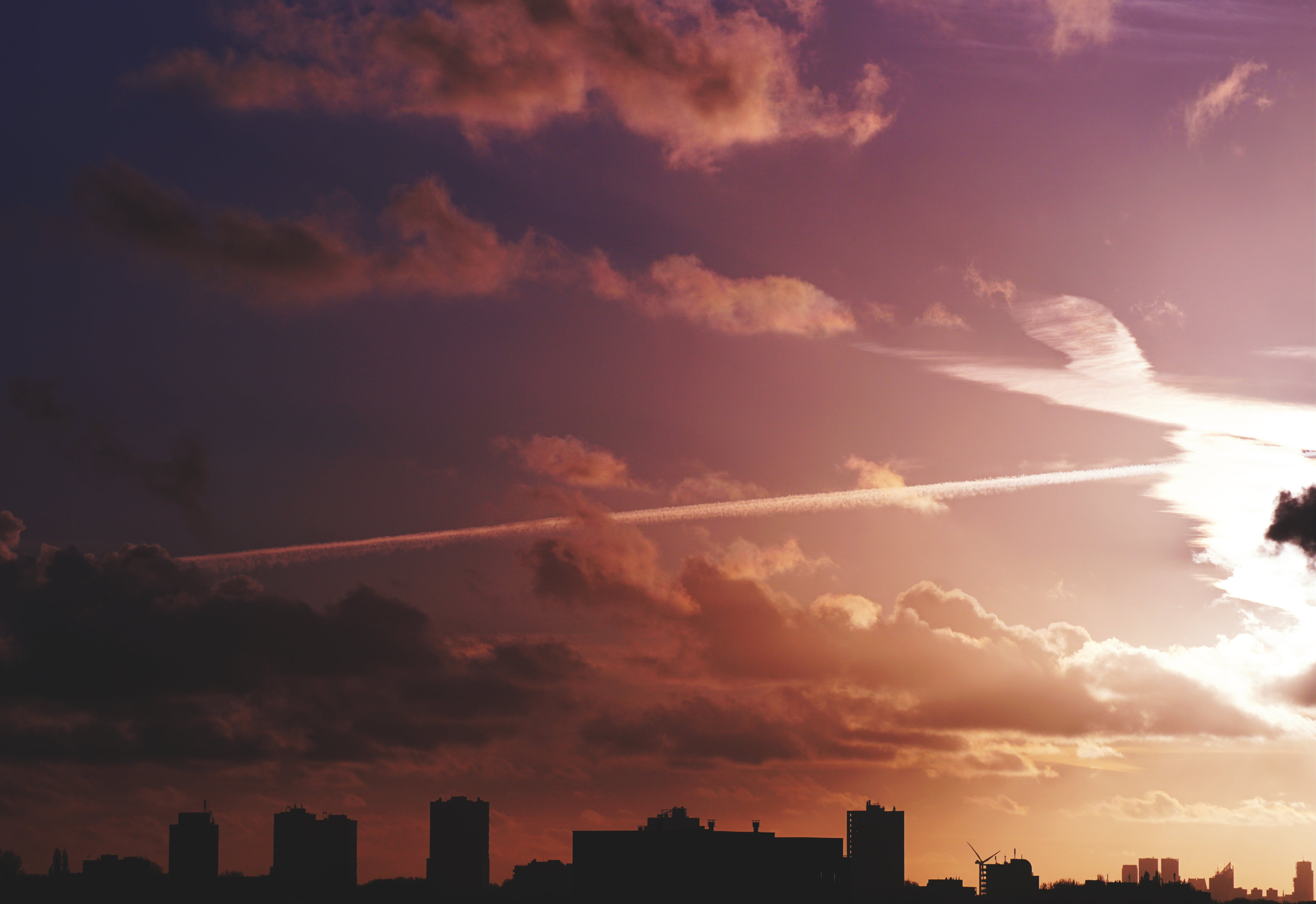 Silhouette of Skyline Under Sunset