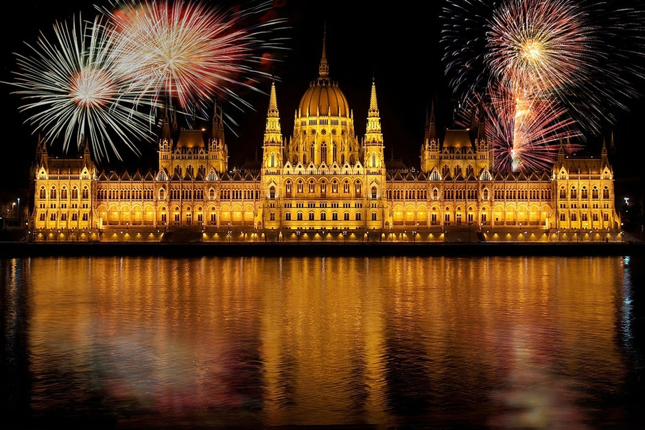 Image of the Budapest Parliament building during festivals of fireworks at night