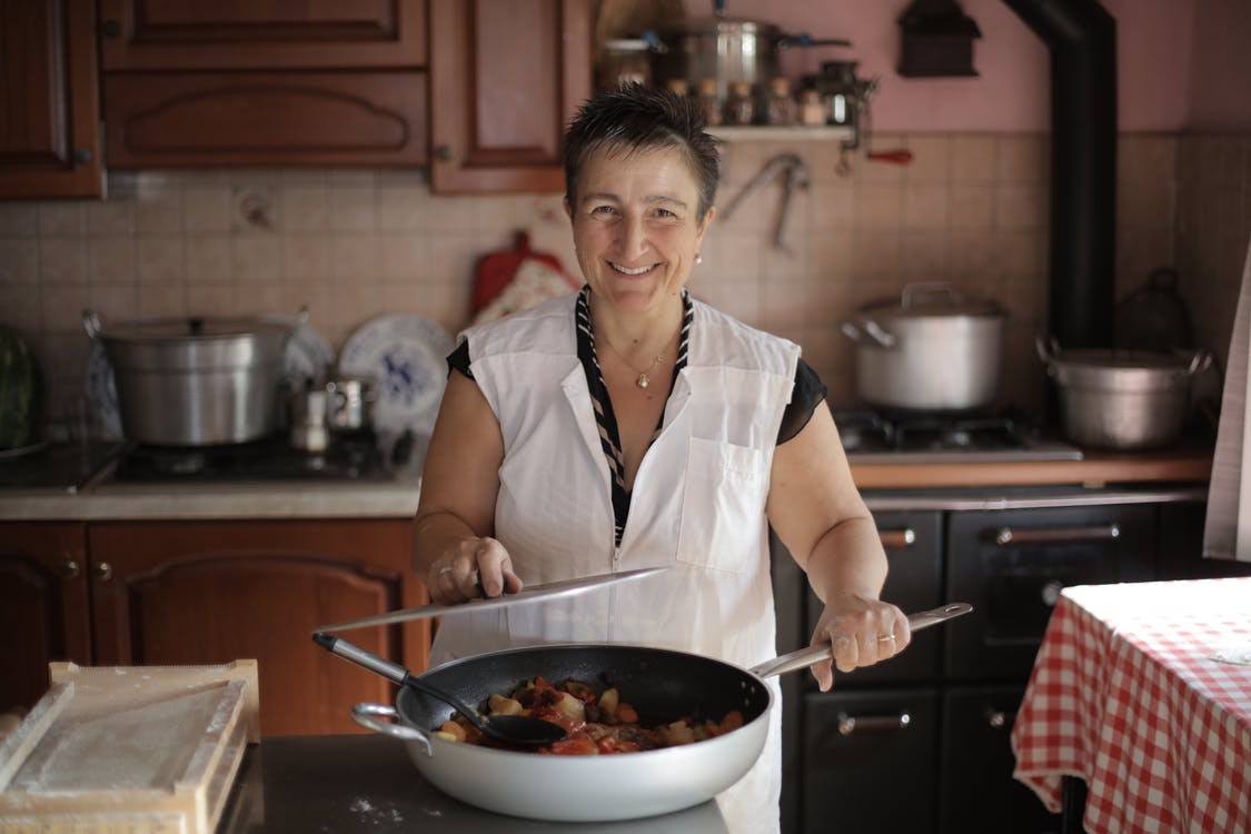 Elderly Woman in White Button Up Shirt Cooked a Delicious Meal