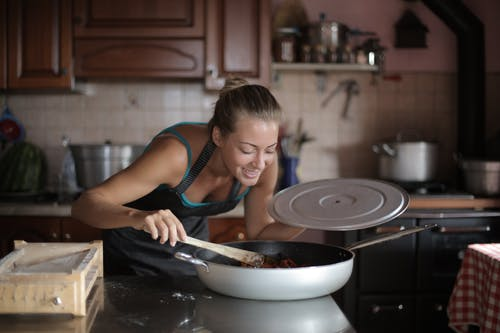 Woman Smiling While Smelling the Food