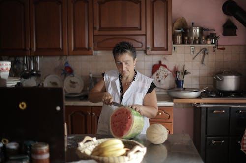 Woman Slicing a Watermelon