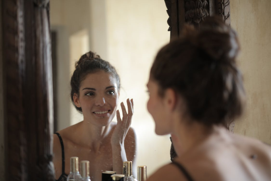 Reflection Photo of Woman Smiling