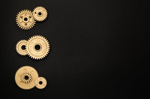 Assorted Gears on Black Surface