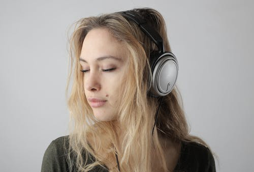 Portrait Photo of Woman Listening to Music