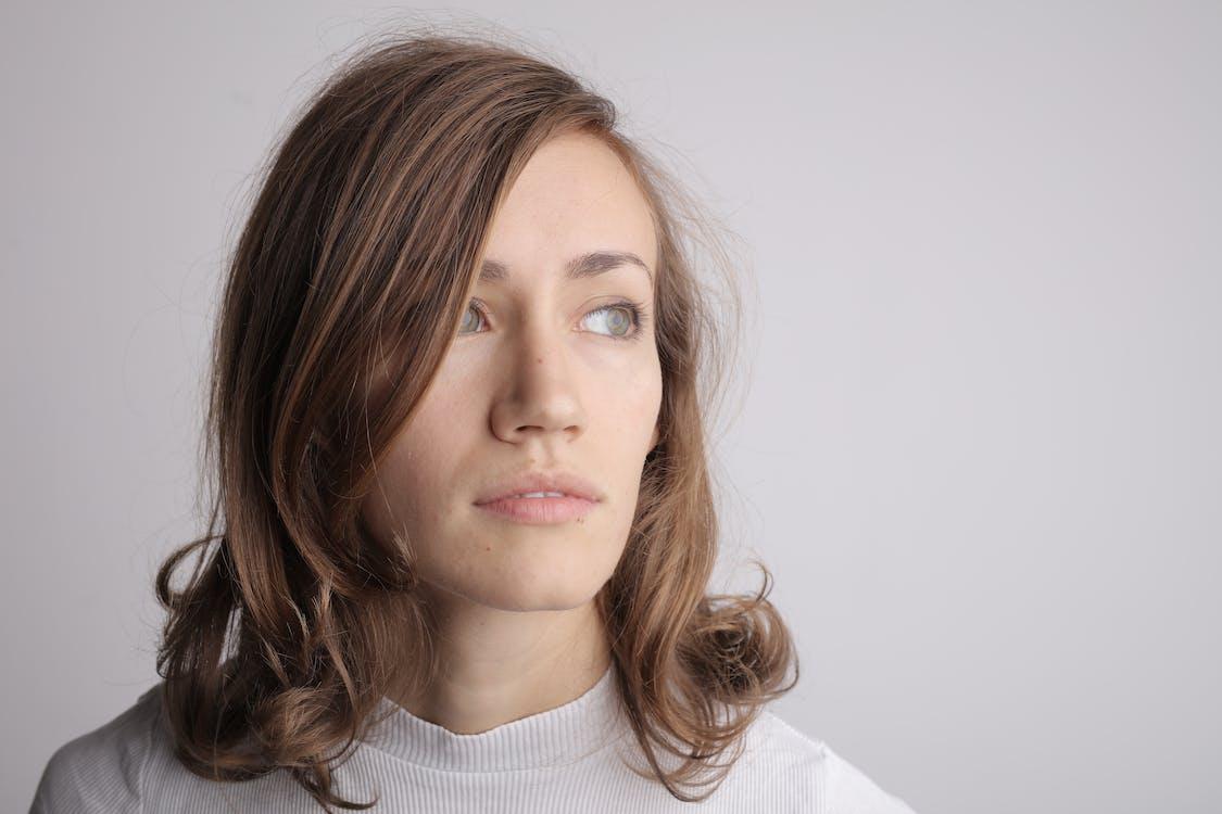 Woman in White Turtleneck Shirt