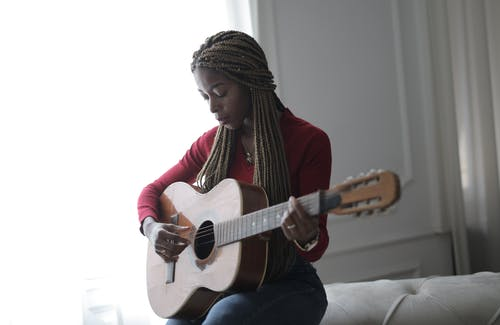 Woman Playing Acoustic Guitar