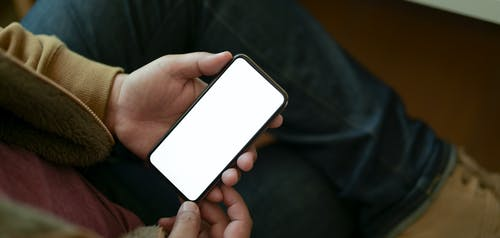 Person Holding White and Black Smartphone
