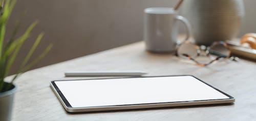 White Tablet on White Table