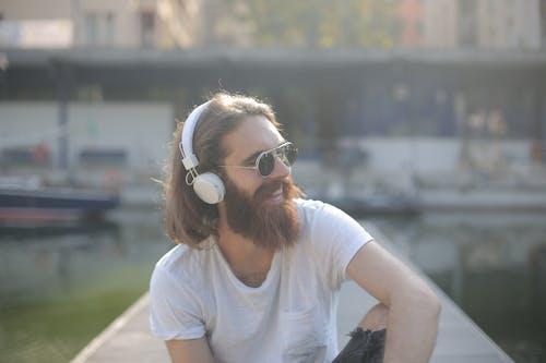 Man in White Crew Neck T-shirt Wearing Sunglasses