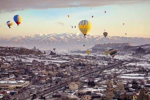 Hot Air Balloons Flying over City