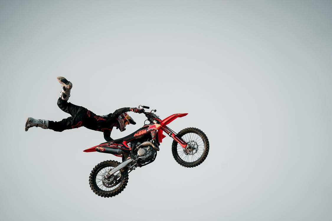 Man Performing crazy things and stunts on Motorcycle