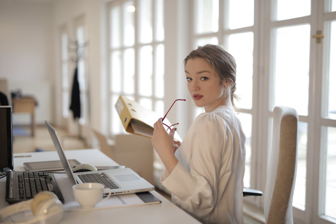 Elegant businesswoman with folder in office