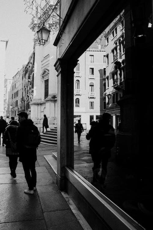 Grayscale Photo of People Walking on Sidewalk