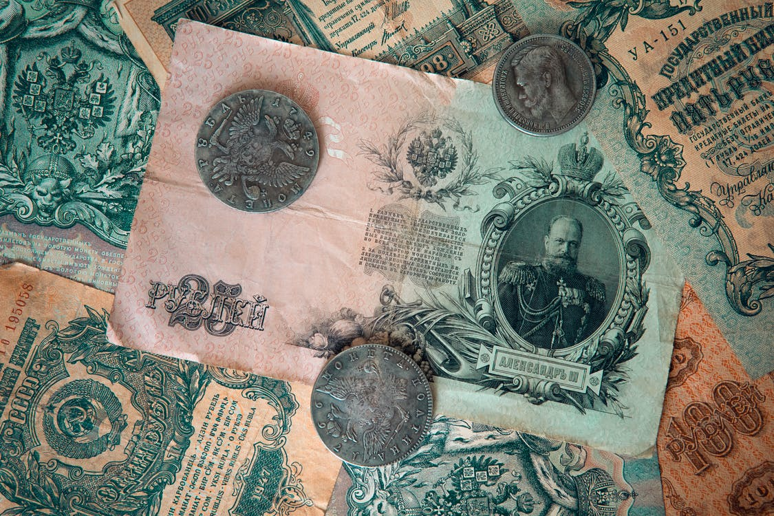 Silver Round Coins on Banknote