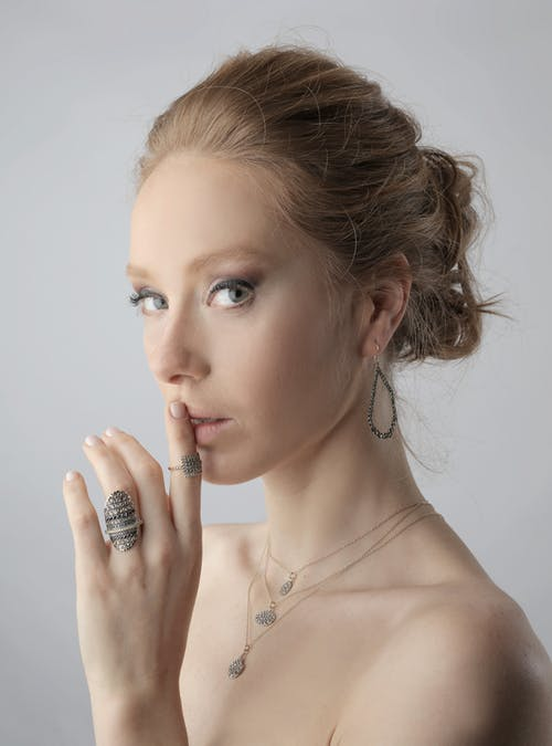 Portrait Photo of Woman With Rings, Earring and Necklace