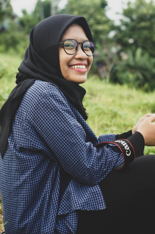 Woman in Black Hijab and Checkered Long Sleeve Shirt