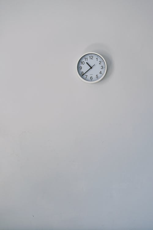 Silver Round Wall Clock Mounted on Wall
