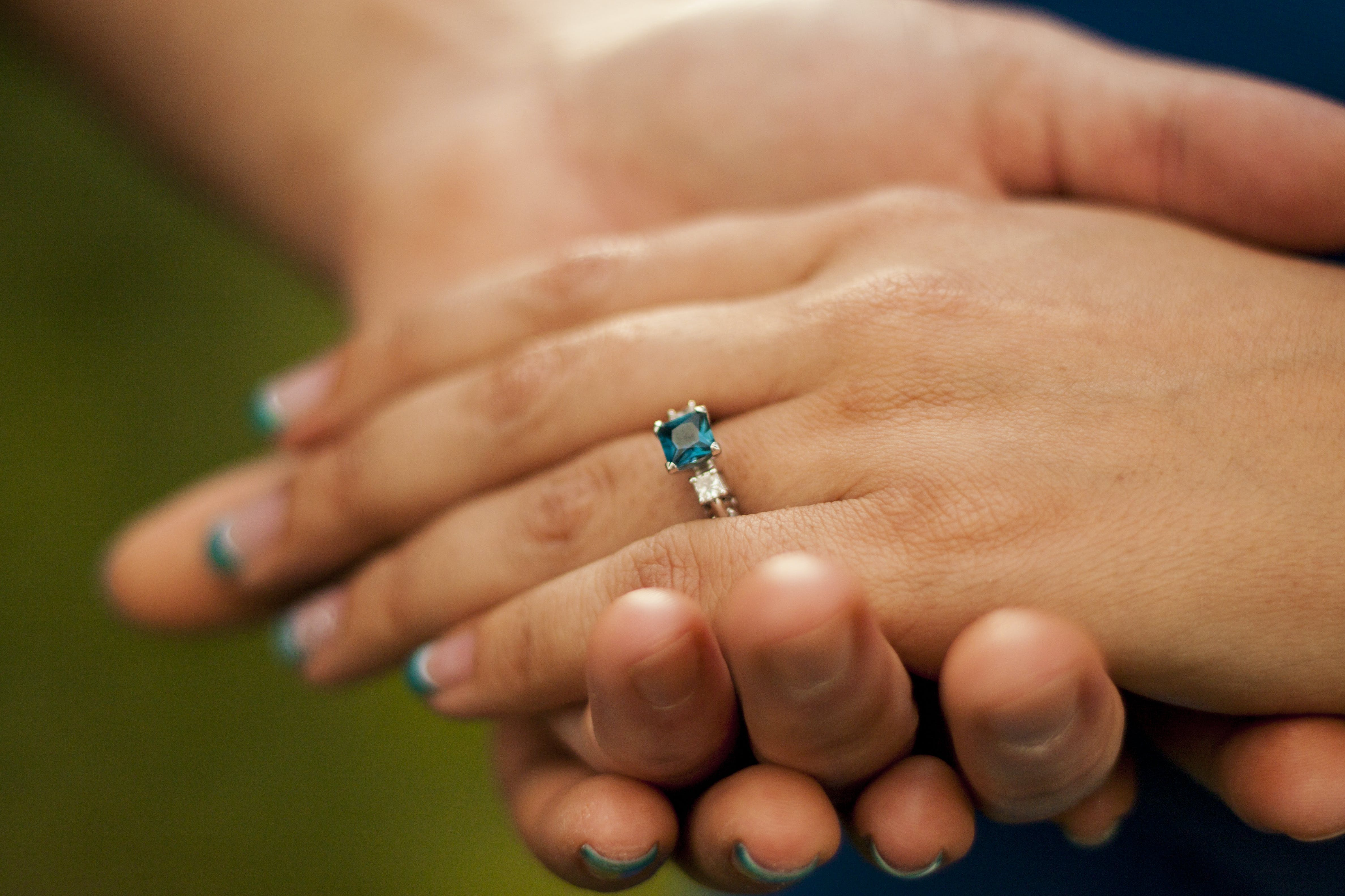 Blue ring, engagement ring, holding hands