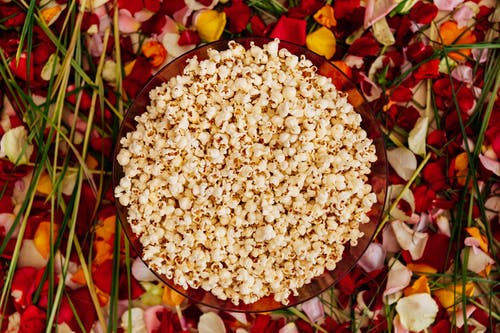 White Popcorn on Colored Flower Petals