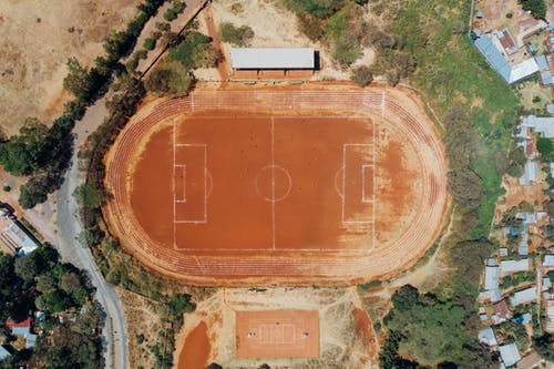 Aerial View of Basketball Court and Football Field
