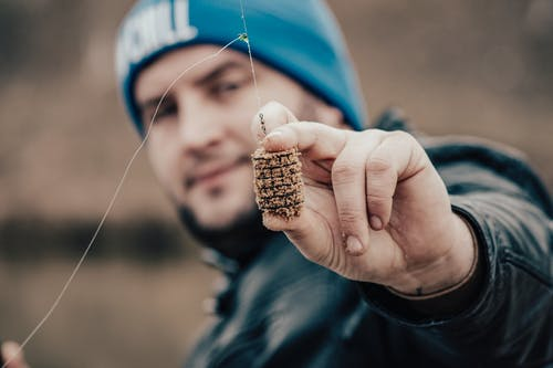 Person Holding Fishing Bait