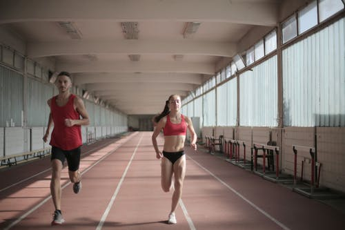 Photo of Man and Woman Running