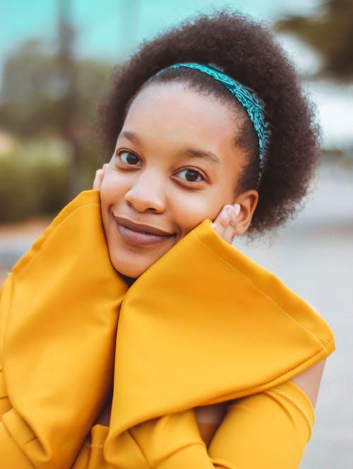 Photo of Woman Wearing Yellow Top
