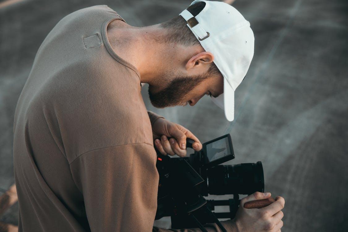 Man in Brown Suit Jacket Holding Black Dslr Camera